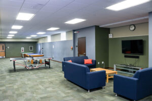 The Bonzel Hall lounge has foosball, pool table, and ping pong tables, plus a large flat-screen TV