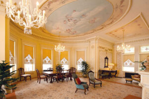 The parlor is tastefully decorated in yellow tones