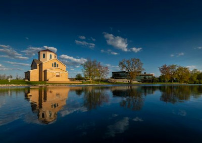 St. Francis Chapel reflecting in Mirror Lake on a sunny evening
