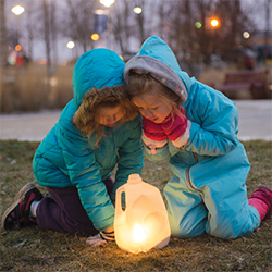 Children looking at a lighted luminary