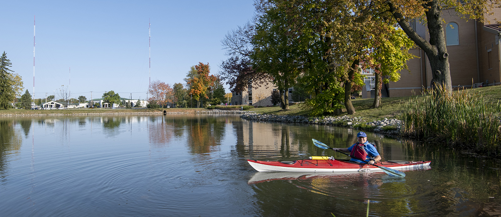 Fr. Zimmer taking his kayak out on Mirror Lake on a beautiful fall day